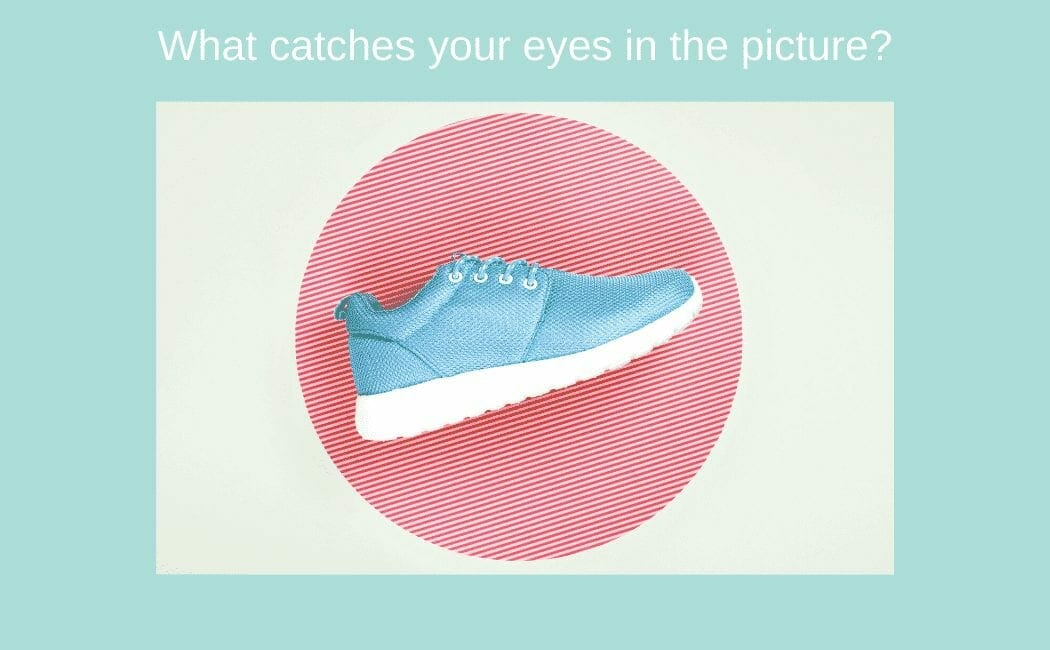 A blue shoe photo with red round background and with a title what catches your eyes?